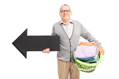 Senor holding a laundry basket and an arrow Royalty Free Stock Images