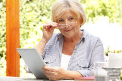 Senor woman with diigital tablet Stock Photo