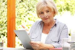 Senor woman with diigital tablet Stock Images