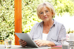 Senor woman with diigital tablet Royalty Free Stock Photos