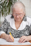Senor woman signing document Royalty Free Stock Photography