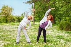 Senor women. Senior women (50s and 60s) stretching outdoors Stock Photography