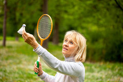 Senor women. Senior woman holding badminton racket Royalty Free Stock Images