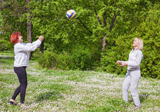 Senor women. Two mature women playing volleyball in he park Royalty Free Stock Photo