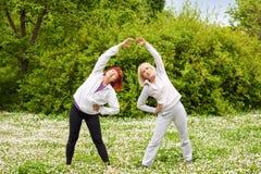 Senor women. Two senior women doing stretching exercise Royalty Free Stock Photography