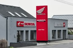 The Honda dealership with red colour and a logo in Senov, Czech Republic