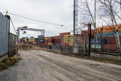Logistic center with containers behind rusty gate Royalty Free Stock Images