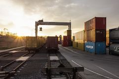 Container terminal for unloading goods from trains to trucks Stock Photo