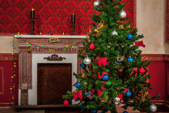 Sensasional vintage Christmas interior with a fire place on back Royalty Free Stock Photos
