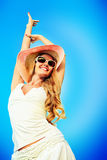 Sense of freedom. Beautiful young woman in elegant hat and sunglasses posing over sky Stock Photo