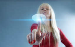 Sense of hightech. Blonde touches the button. Future series stock photo