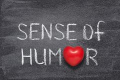 Sense of humor heart. Sense of humor phrase handwritten on chalkboard with red heart symbol instead of O royalty free stock photography