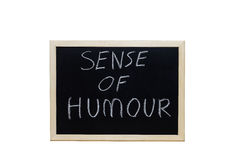 SENSE OF HUMOUR written with white chalk on blackboard Stock Photos