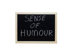 SENSE OF HUMOUR written with white chalk on blackboard Stock Photos