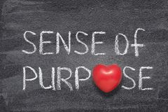 Sense of purpose heart. Sense of purpose phrase handwritten on chalkboard with red heart symbol instead of O stock images