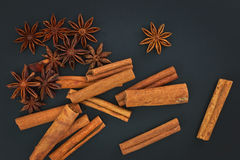 Sense of Spices cinnamon and star anise on black background Stock Photos