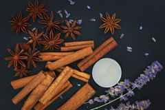 Sense of Spices cinnamon and star anise whit candle on black background Royalty Free Stock Photos
