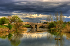 Sense of storm - bridge near Balgarene, Bulgaria. The Old stone bridge over the Osam river. This amazing place is located near Balgarene, in Bulgaria. The nature Royalty Free Stock Photo