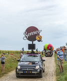 Senseo Caravan on a Cobblestone Road- Tour de France 2015 Royalty Free Stock Photography