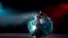 Sensetive belly dance movements of young and