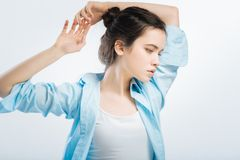 Sensible sincere woman moving hands. Little exercise. Brunette sweet pensive woman rising hands while staying on the background and staring aside stock photos