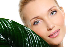 Sensitive beautyful woman face with a plant Stock Images