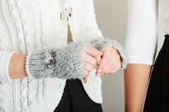 Sensitive female hands with gray gloves. Royalty Free Stock Image