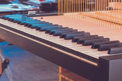 Construction of a piano, piano flaps in wood worksho, Grand Piano Construction. The sensitive inner mechanism of the piano translates all the nuances of your Stock Image
