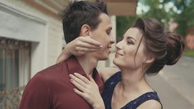 Sensitive kiss. Girl closes man`s eyes with his hands for surprise stock video