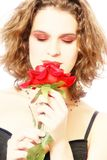 Sensitive woman with red rose in high-key Royalty Free Stock Images