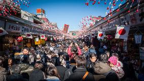 Senso-ji Temple at New Year. Senso-ji Temple, Tokyo - January 03 2015: Thousands make their annual New Year visit to one of Japan's most famous temples Royalty Free Stock Images