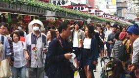 Sensoji Temple Tokyo Japan. Time Lapse of People Shopping Outside Sensoji Temple - Tokyo Japan stock footage