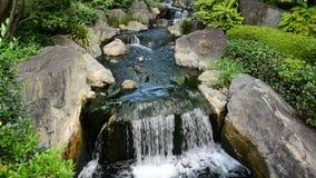 Sensoji Temple Tokyo Japan. Waterfall runs into a Coy Pond at Sensoji Temple Tokyo Japan stock video footage