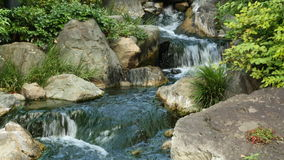 Sensoji Temple Tokyo Japan. Waterfall runs into a Koi pond at Sensoji Temple Tokyo Japan stock video footage