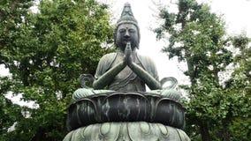 Sensoji Temple Tokyo Japan. Zoom Out of Statue of Buddha at Sensoji Temple - Tokyo Japan stock footage