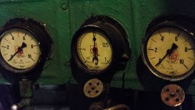 Sensor control panel with three retro dials. In the engine room of an ice breaker royalty free stock image