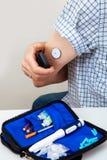 Sensor diabetes checkup glucose man system sugar monitoring scan test hand skin medicine syringe table white background stock image