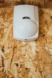 Sensore del rivelatore di moto nell'azione, fondo del osb Fotografia Stock