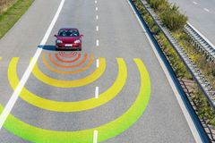 Sensors monitor the traffic in a modern car on a fast road... stock photo