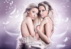 Sensual. Nude portrait of two sensual young girls royalty free stock image