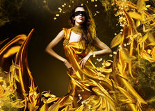Sensual adult woman in golden fabric Stock Photo