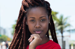 Sensual african woman with dreadlocks in the city. In the summer Stock Photo