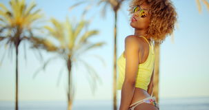 Sensual Afro American Girl Posing on The Beach. Sensual Afro American Girl Posing on The Tropical Beach in Sunglasses. Slow Motion Video stock footage