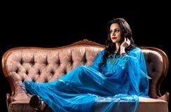 Sensual arabic girl on the retro sofa Stock Photo