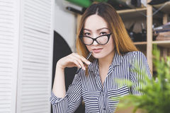 Sensual asian girl at workplace Royalty Free Stock Image