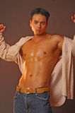 Sensual asian male. Sensual Asian open shirt in a sexy pose Stock Images