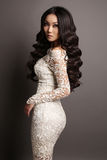 Sensual asian woman with long dark hair in elegant lace dress Stock Images