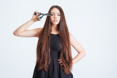 Sensual attractive woman holding scissors in front of her eye Royalty Free Stock Photo