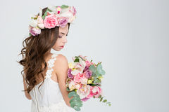 Sensual attractive woman with long curly beautiful hair in wreath Stock Photography