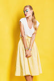 Sensual attractive woman in yellow skirt Stock Photos
